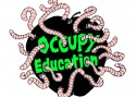 "Apple with the words ""Occupy Education"" written inside it and overflowing with worms."