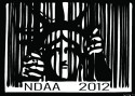 "Lady Liberty imprisoned by a barcode, text reads: ""NDAA 2012"""