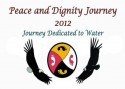 "Text: ""Peace and Dignity Journey 2012 --- Journey dedicated to Water"" over image: a circle stylized into 4 equal parts: white foot on red background, black foot on yellow background, red foot on white background, and yellow foot on black background. To the left of circle is an eagle, to the right is a vulture."
