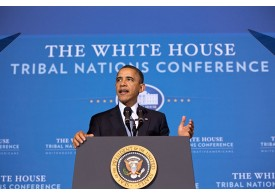 Obama speaking at podium at The White House for the Tribal Nations Conference on December 5, 2012