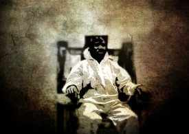 "stylized sepia portrait of man on electric chair. style is ""posterized"": a minimal amount of color is used to express highlights and shadows."