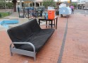 Picture of a sofa on the sidewalk of Safe Park