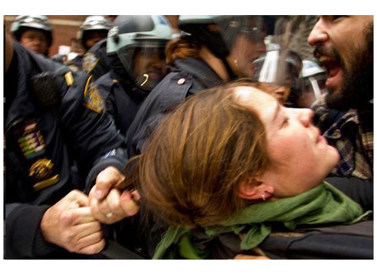 Girl getting dragged by the hair by Police