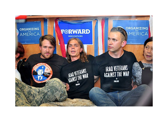 Iraq War veterans (left to right) Michael Thurman, Scott Olsen, and Joshua Sheppard occupying Obama's campaign office in Oakland in support of Bradley Manning.