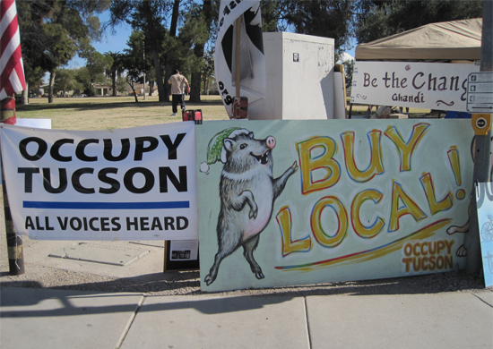"""Signs from Occupy Tucson encampment at De Anza: """"Occupy Tucson -- All Voices Heard"""" """"Buy Local"""" """"Be The Change"""""""