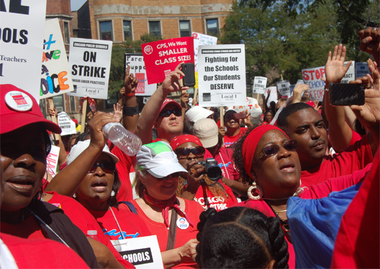 Chicago Teachers Union strike. Protesters carring signs and marching through streets.