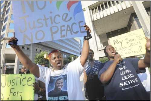 Protesters in Baltimore bringing attention to extrajudicial killings