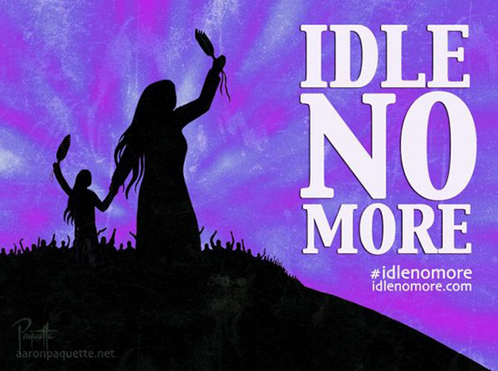 "Silhouette of mother and daughters holding hands while both holding up feathers, in the background a crowd is raising their hands into the air. In large text ""Ide No More"", underneath it reads, ""#idlenomore"" and ""idlenomore.com"". Further down a signature and the URL ""aaronpaquette.net"""