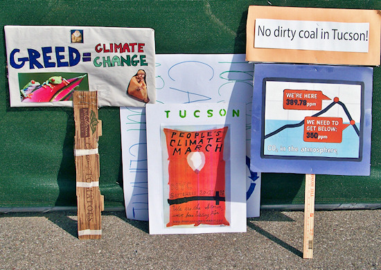 Signs at September 21 Tucson solidarity march