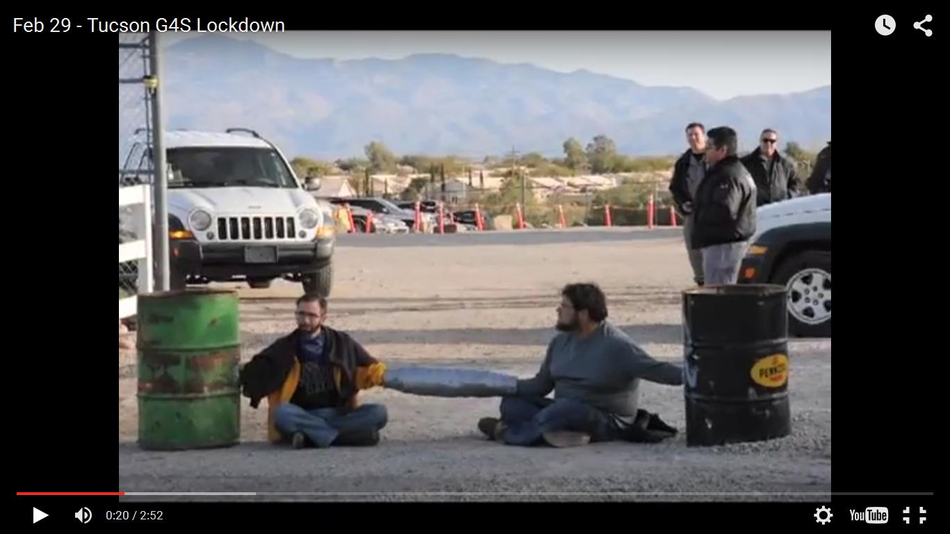 Picture of Occupy Tucson protesters Jonah Clarke and Landfill blockading G4S facility in Tucson