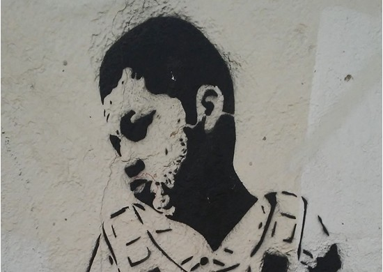 An anonymous graffiti artist painted Jose Antonio Elena Rodriguez in a bulletproof vest near the spot in Nogales, Sonora, where he died